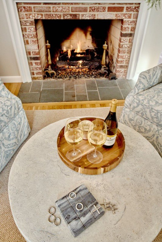greenwich interior design remodel ri dining area open concept fireplace faux concrete table