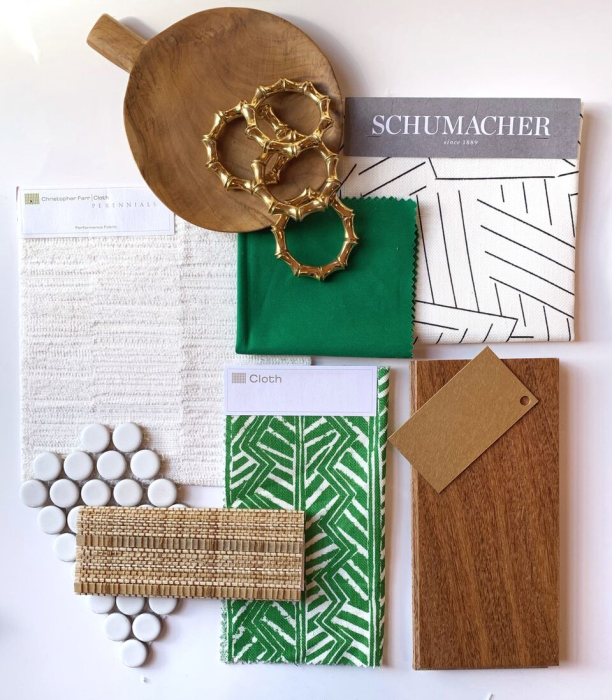 blakely-interior-design-green-emerald-flat-lay-warm-wood-tones-brown-white-patterh-fabric