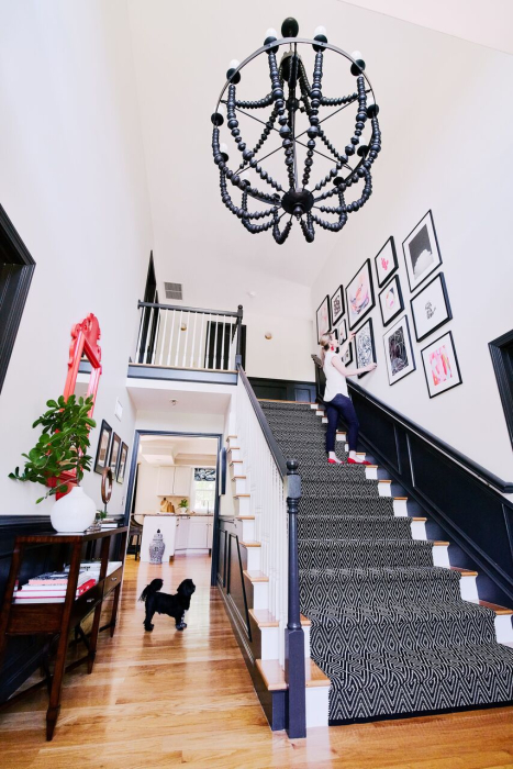 professional interior design home black staircase runner white bannister black chandelier ri