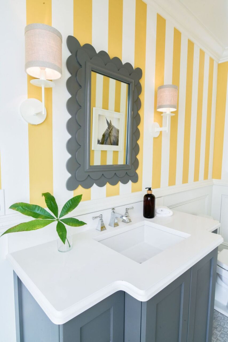 professionally designed powder room yellow stripes gray cabinets fresh