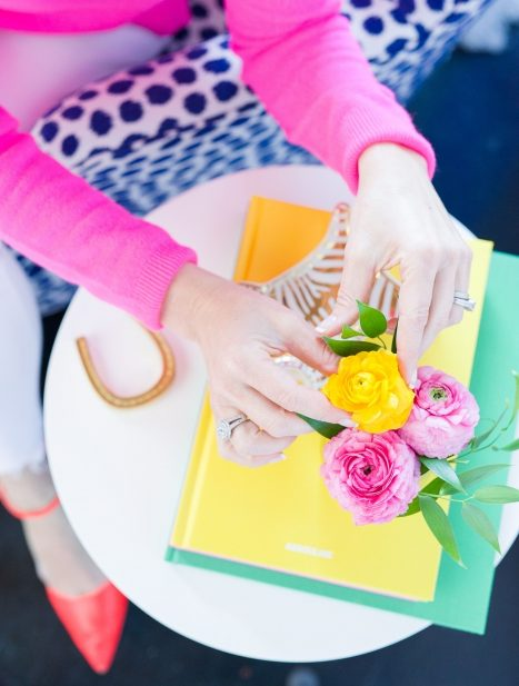 blakely interior design styling table top colorful pink shirt yellow book full service design