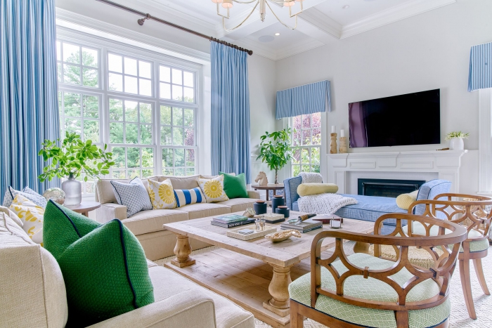 colorful living room light blue drapery curtains wooden chairs yellow green pillows full service styling