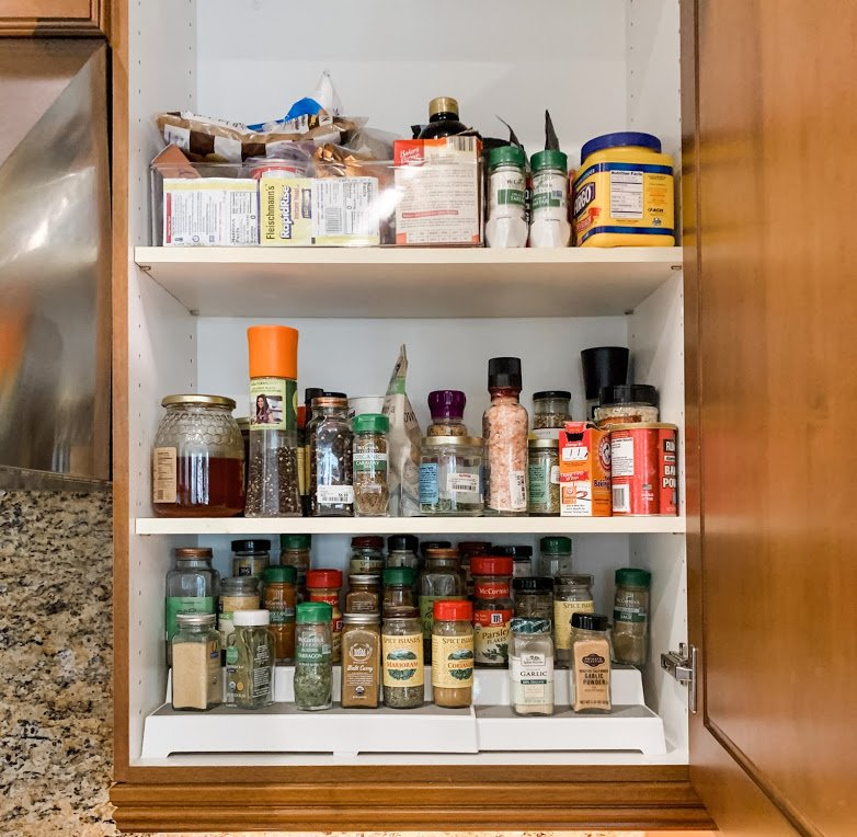 before spice cabinet cluttered