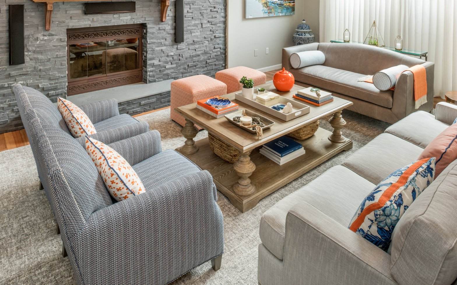 blakely interior design colorful living room blue orange classic vibrant chandelier stone fireplace