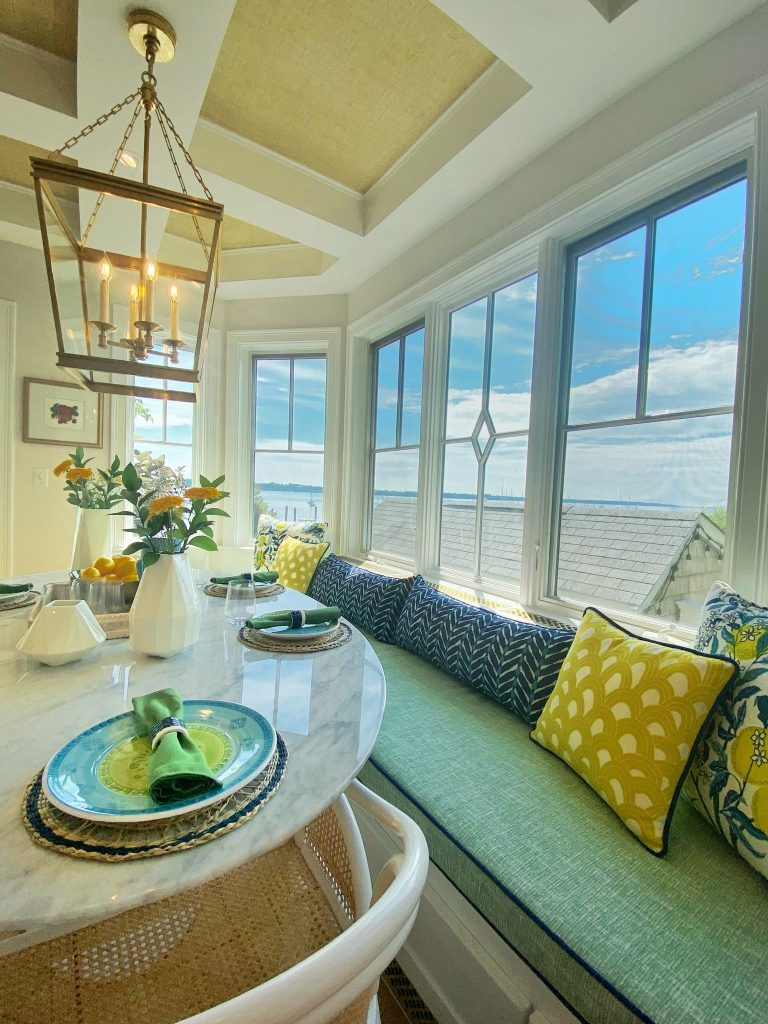 blakely waterfront kitchen remodel breakfast nook carrara marble builtin banqueete green blue yellow