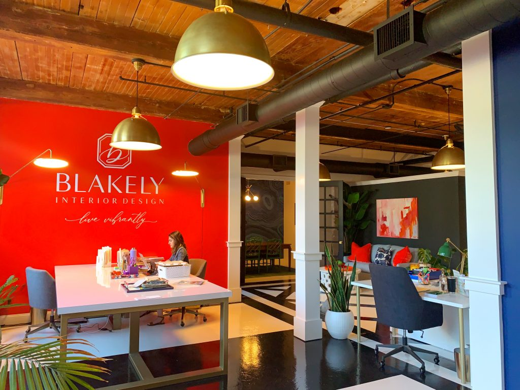 red accent wall blakely interior design open office space studio firm kingstown RI