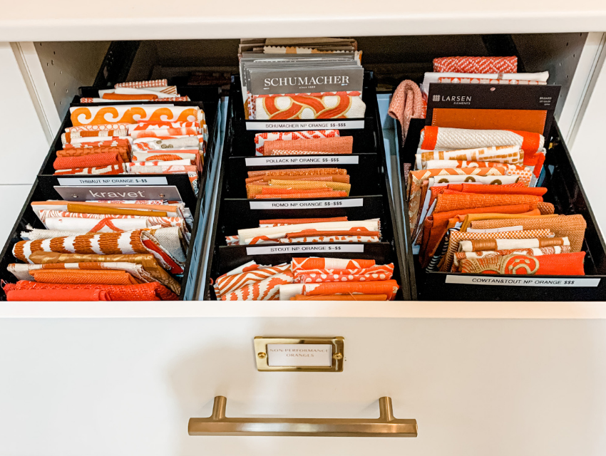 blakely interior design kingstown ri behind the scenes design library fabric orange shades arranged in a drawer