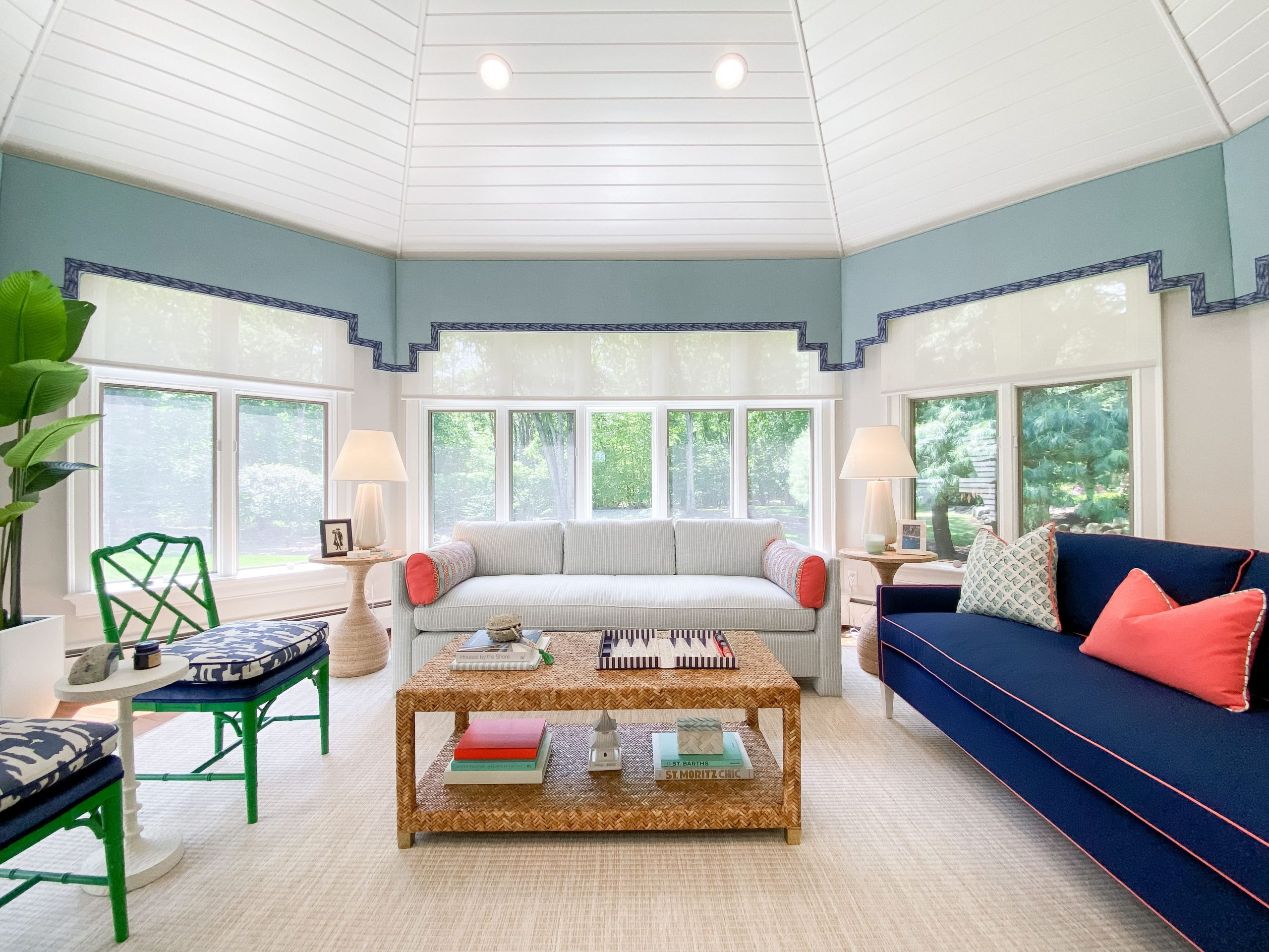 blakely interior design kingstown ri sunrooms and summer homes in new england vibrant green accents blue sofa coral pillow large woven coffee table