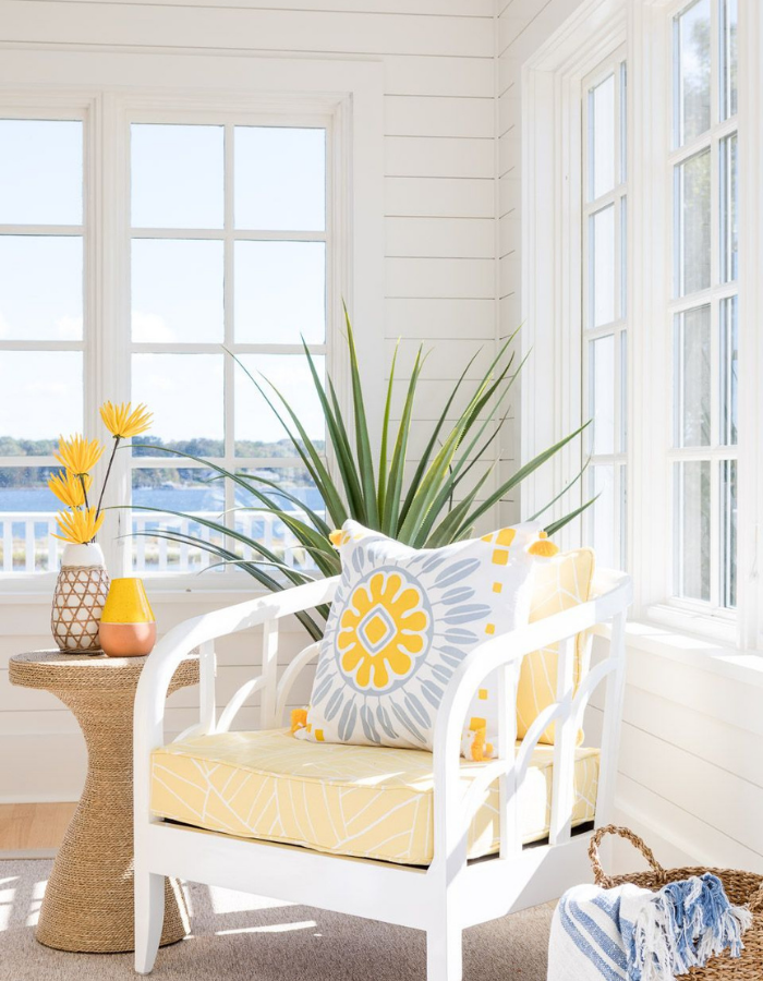 blakely interior design narragansett new england home accessories coastal sunroom with yellow accents white chair